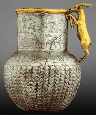 Silver and gold vase with a Handle in the form of a goat from Tell Basta and dating to the 19th Dynasty.