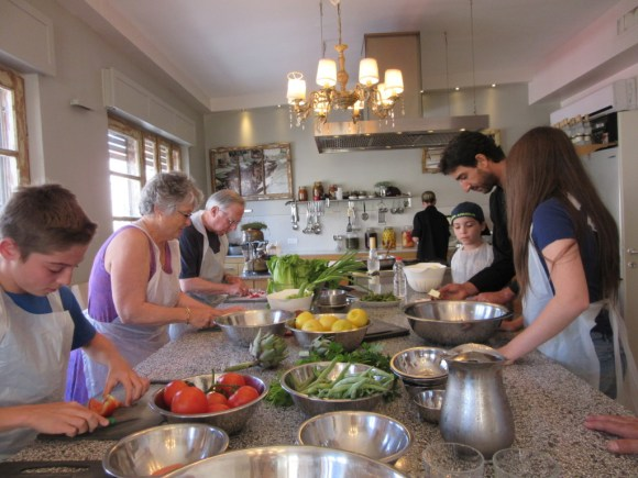 Touring Israel - Yossi, Tali's sous chef turned on invigorating up beat music and bounced around the kitchen directing us.