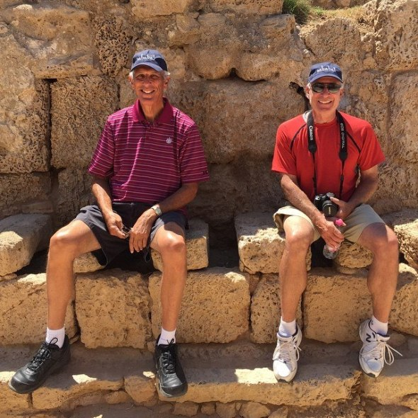 Touring Israel - Token photo of our clients testing out the Roman toilets in Caesarea