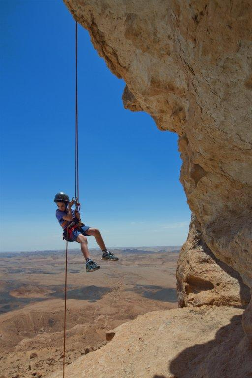 Child rappelling in the Rimon Crater (Photo from goisrael.com)