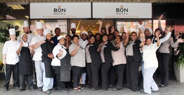 Hotel staff celebrate outside BON Bloemfontein