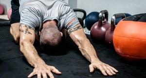 Man stretching in a gym