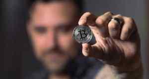 Man holding a bitcoin