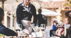 A waiter serving guests