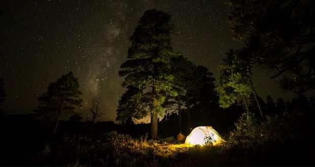 tent at night beneath a starlit sky