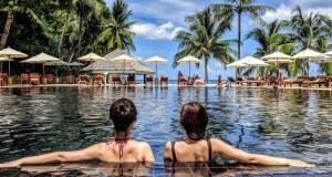 Two women in a resort swimming pool