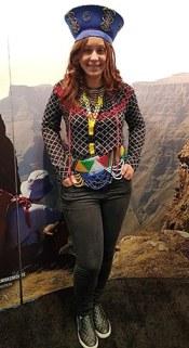 Tourist posing in Zulu tribal dress