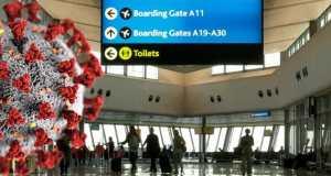 Airport terminal with Coronavirus graphic