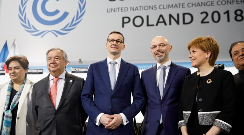 Polish Prime Minister Mateusz Jakub Morawiecki and others in front of the official COP24 poster