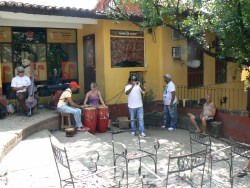 street musicians playing for change
