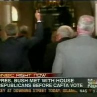 Bush Gives Press the Finger