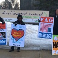 LGBT Activists Protest Outside Michigan Church Where Pastor Compared Gays To Axe Murderers