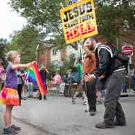 Young Girl with Gay Pride Flag Faces Down Street Preacher: VIDEO