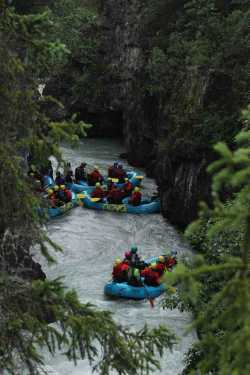 Whitewater rafting down Six Mile Creek, Alaska, in ManAboutWorld gay travel magazine and Towleroad