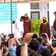 Crowd Jeers as Two Men are Caned 83 Times for Gay Sex in Indonesia