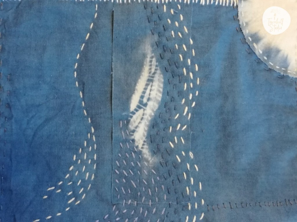 close up of running stitches with guntai shibori