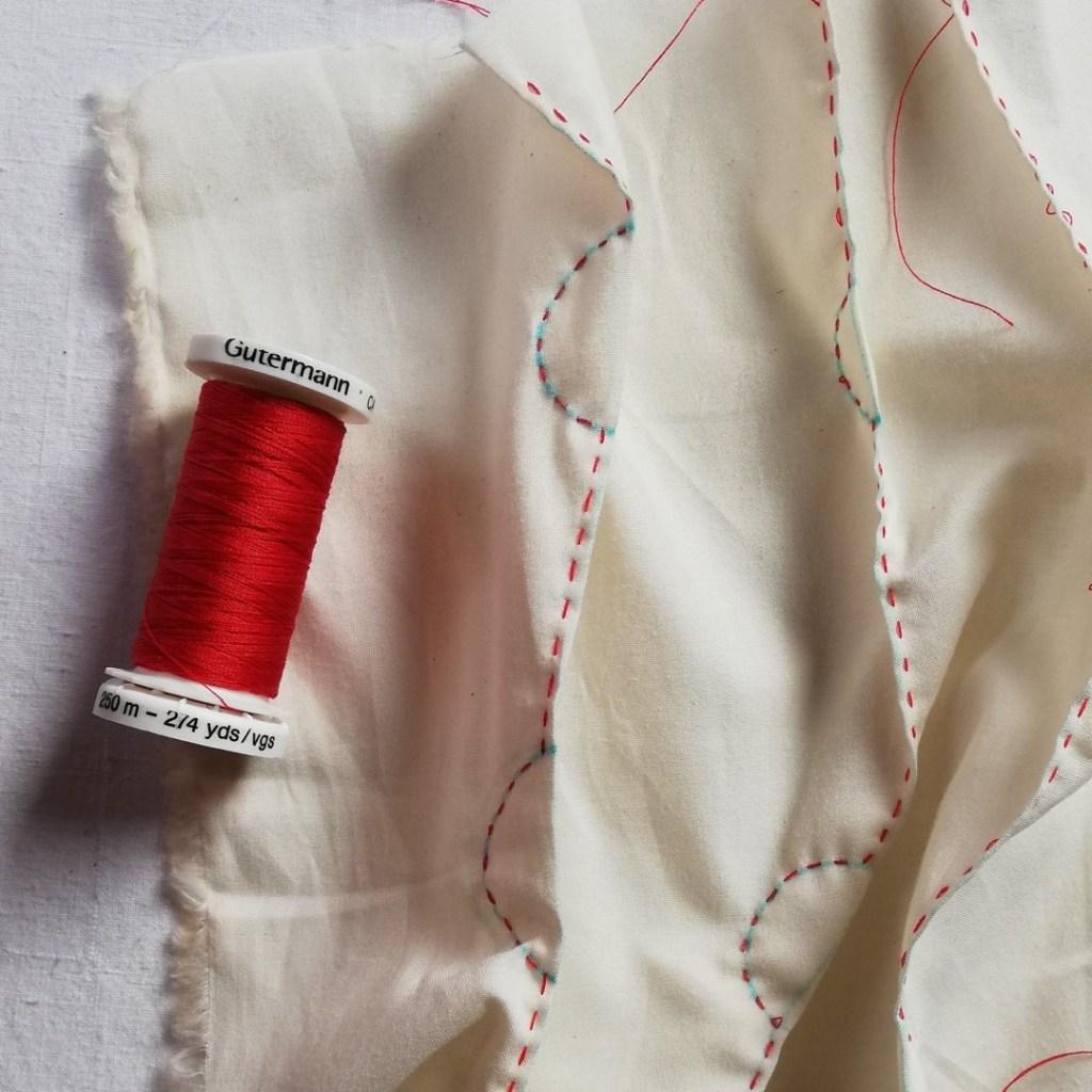 cream fabric with shibori stitching in red