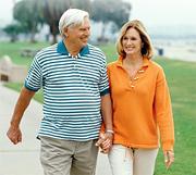 An elderly couple walking near beach. - Copyright – Stock Photo / Register Mark