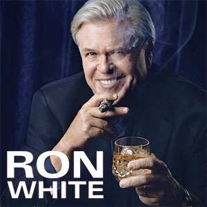 ron white smoking a cigar with drink in his hand