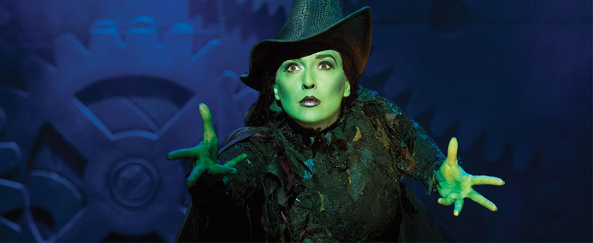 Elphaba conjures a spell dressed in black