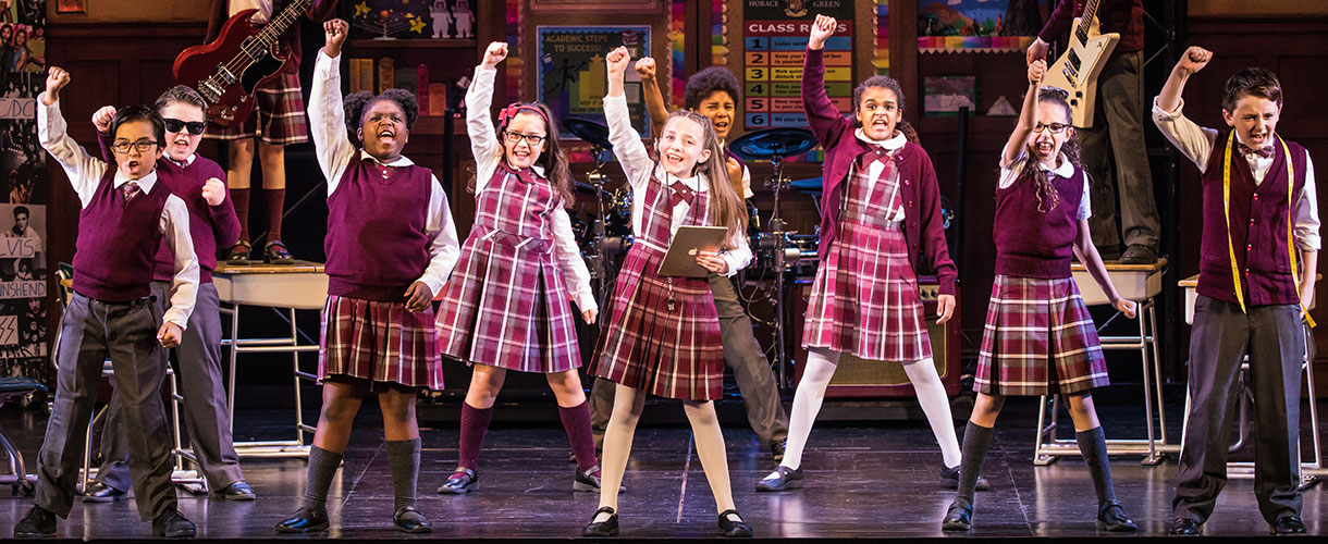 The student ensemble rocks out in School of Rock