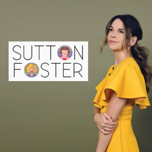 Sutton Foster posing in a yellow dress.