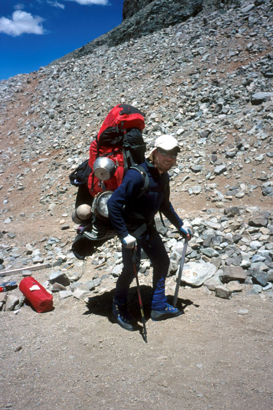 Heavily laden, Kyle sets off for Base Camp