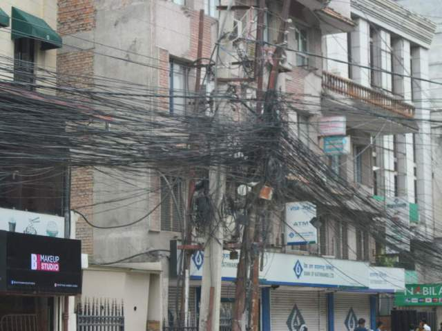 Jumble of wires on Kathmandu telephone pole