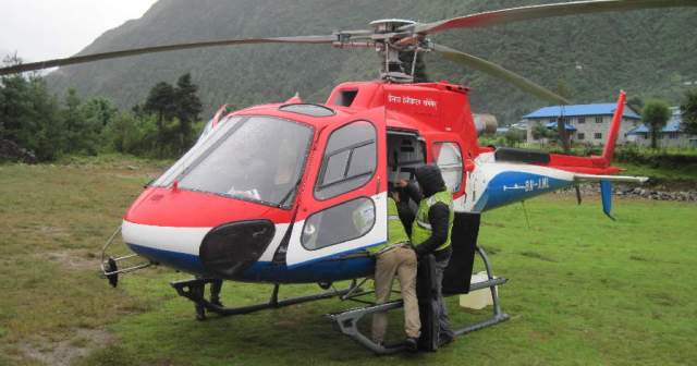 Unloading our copter at Lukla