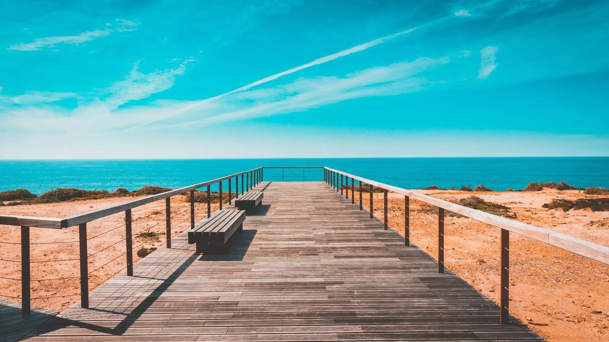 beach-bench-boardwalk-clouds-462024