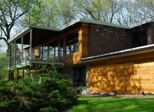 Modern Home with Flat TPO Roof and Wood Siding