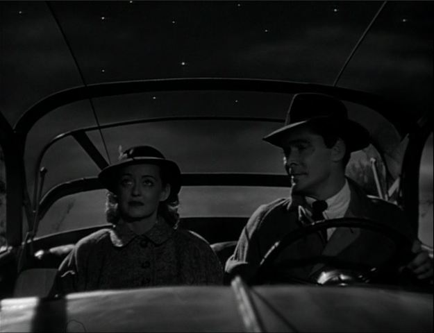 Bette Davis, Barry Sullivan: Out for a spin in a transparent car.