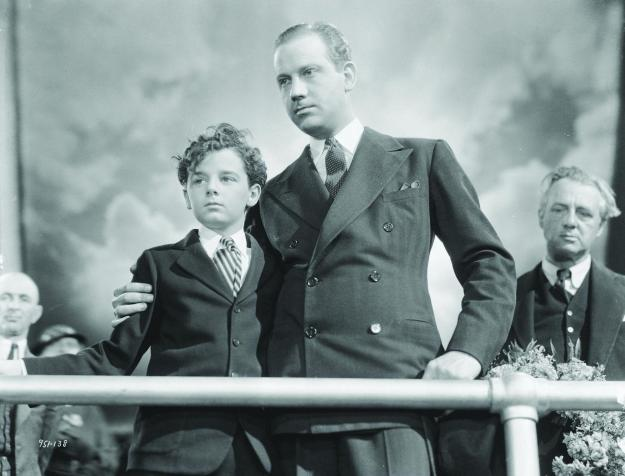 With Freddie Bartholomew in the final scene of 'Captains Courageous.'