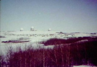 Radar towers looking north, likely from a grid-road vantage point, CFS Dana, Saskatchewan.