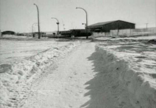 Looking East at the Guardhouse and gymnasium. Barracks on the left. CFS Dana, Saskatchewan.