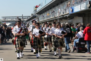 The Gordon Pipers parade through the paddock at Indianapolis.