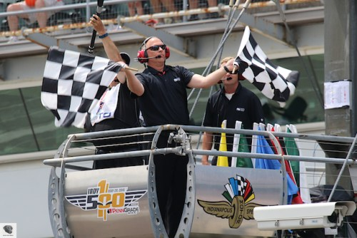 Tom Hansing waves the checker flags for the Freedom 100