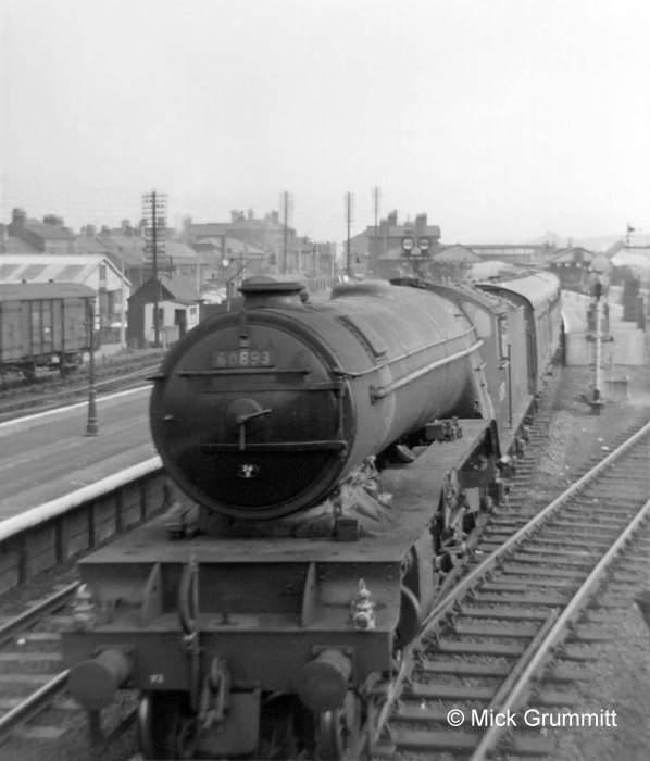 V2 locomotive No.60893 of New England shed, Peterborough, leaves for the north. The two headlamps, one above each buffer, denote an express passenger train. These headlamp codes were an aid to signalmen in identifying trains so they could ensure that the most important traffic was given priority. The white-painted lamp cases were themselves a visible indicator in the daytime. During the hours of darkness they were lit by an oil lamp inside, showing a white light to the front through a glass lens. Photograph by Mick Grummitt.