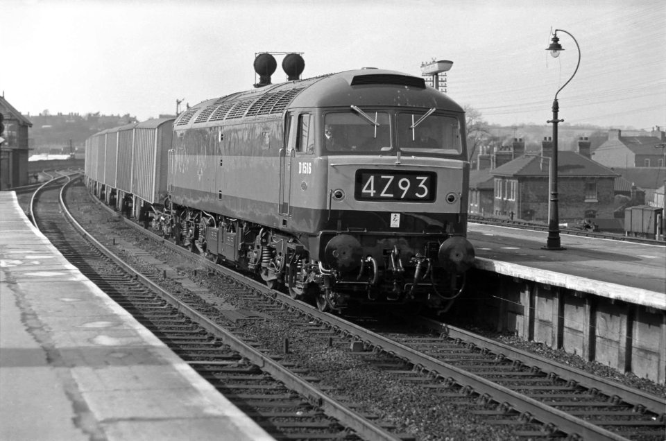 This southbound Class 4 express freight is headed by Brush Type 4 locomotive No. D1516 on 18th April 1963. The locomotive was practically brand new when this picture was taken, having entered traffic on 10th April. It was one of the pilot order for 20 locomotives (D1500 to D1519) of a class of which eventually more than 500 examples were built. Amazingly D1516 still exists, being preserved at the Midland Railway Centre, Butterley in Derbyshire by The 47401 Project / 47401 Diesel Locomotive Ltd. (see http://www.47401project.co.uk/). Photograph by Cedric A. Clayson, © John Clayson