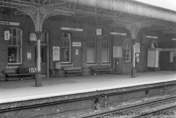 This view shows the windows to the former Dining Room (central) and a further window just beyond the post box. This single window we think was originally an additional entrance to the platform from the Booking Hall. The only entrance in use at the time of this photograph can just be seen behind the Ticket Booth on the right. Copyright Image - Mel Smith