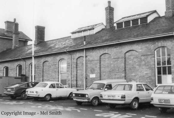 Continuing on along Station Road, this line of single storey buildings link into the main station entrance seen on the left. Copyright Image - Mel Smith