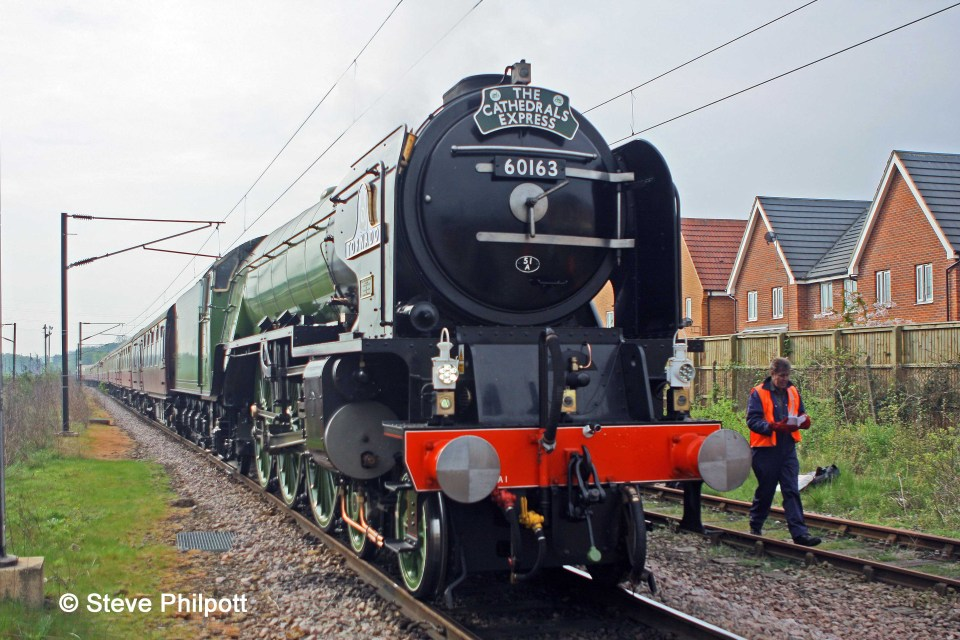Jeremy Clarkson walks past Tornado in Grantham Down Yard during the booked water stop.