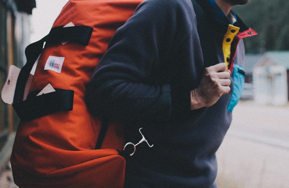 topo x woolrich duffel bag model