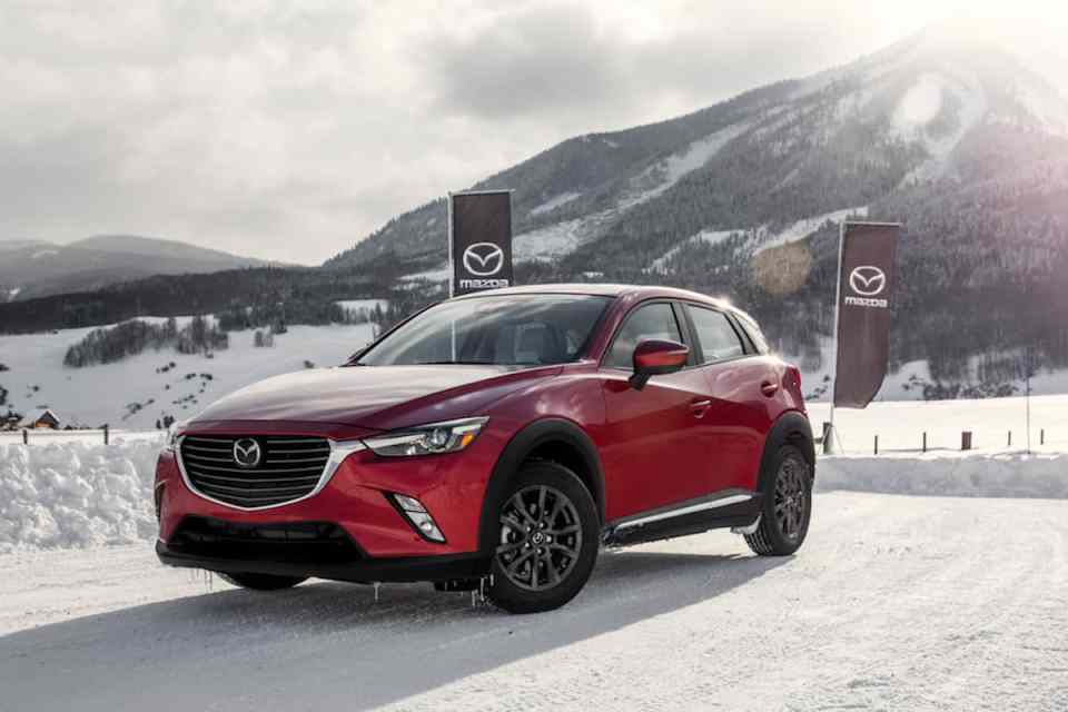2018 mazda cx-3 review front side view red
