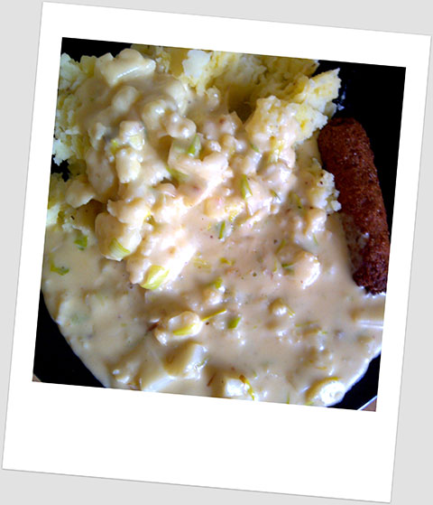 Dinner Day 17: Mashed Potato With A Garlic, Cauliflower & Leek Cheese Sauce & A Soya Sausage.