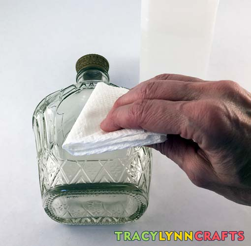 Wipe the crown bottle with rubbing alcohol to remove any oils from handling the bottle