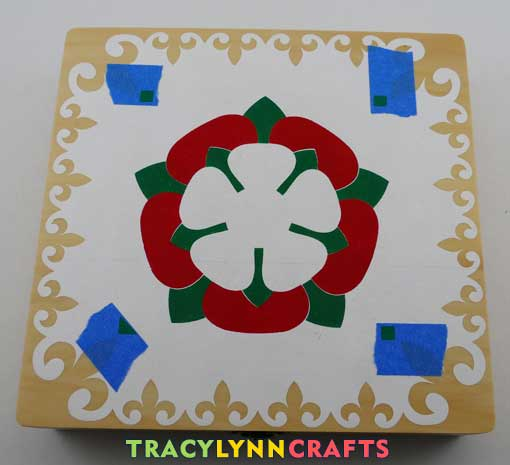 Stencil the red Tudor Rose petals then remove the stencil