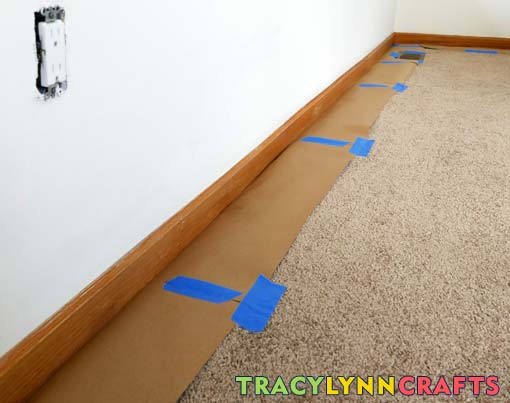 Use heavy paper to tuck under the baseboards to protect carpeting