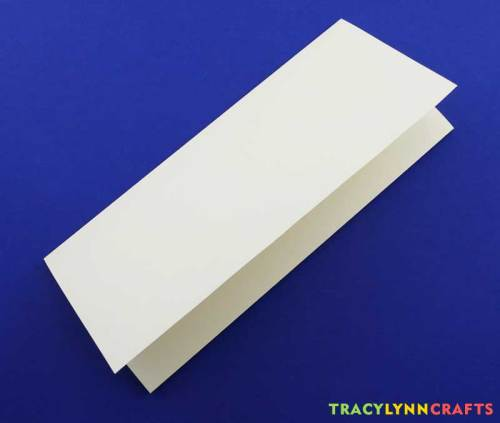 Fold your paper into thirds to prepare for stenciling