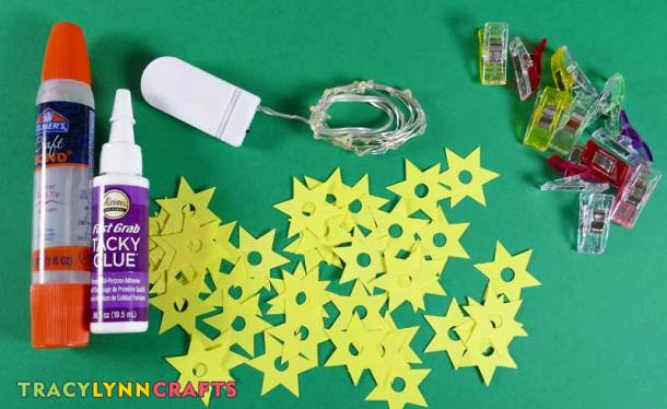 To make the LED stars you need a strand of LEDs, paper stars, and glue